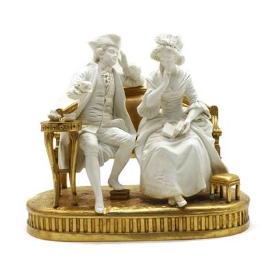 Lot 53 - A Sevres style bisque porcelain conversation group