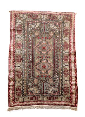 Lot 153 - A Turkish silk and gold-coloured metal rug