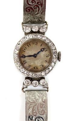 Lot 169 - An Art Deco ladies' diamond set mechanical cocktail watch, c.1925