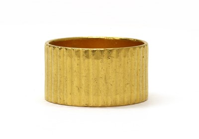 Lot 1071 - A 22ct gold flat section wedding ring