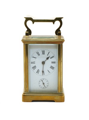 Lot 75 - A French brass carriage clock
