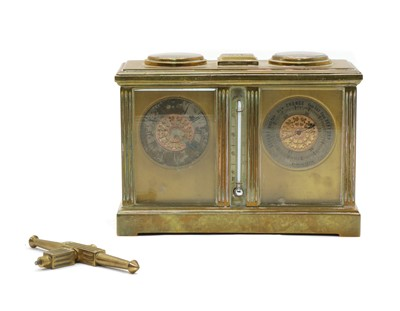 Lot 72 - A late 19th century brass combination carriage clock