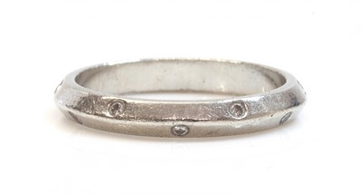 Lot 42 - A platinum chevron section diamond set wedding ring