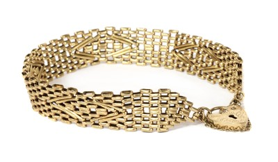 Lot 1114 - A 9ct gold gate bracelet