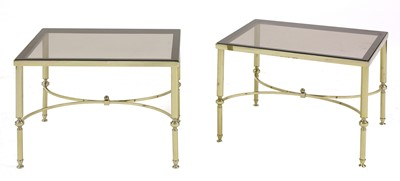 Lot 466 - A pair of brass side tables