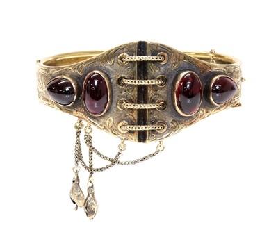 Lot 65 - A Victorian gold garnet set hinged bangle, c.1860