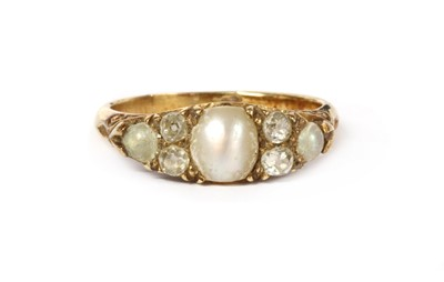 Lot 1004 - A Victorian gold split pearl and diamond ring