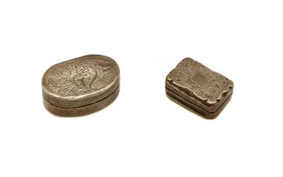 Lot 18 - Two small 19th century silver vinaigrettes
