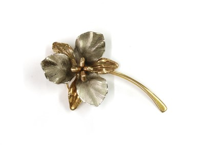 Lot 1056 - A 9ct yellow and white gold flower brooch, by Ecco