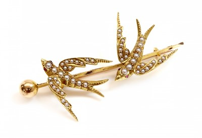 Lot 100 - A gold and split pearl swallow brooch, c.1900