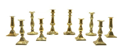 Lot 92 - Five pairs of 19th century brass candlesticks