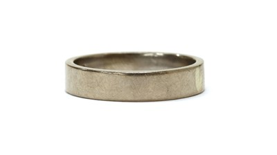 Lot 1077 - A white gold flat section wedding ring