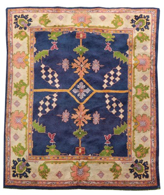 Lot An Arts and Crafts Donegal rug