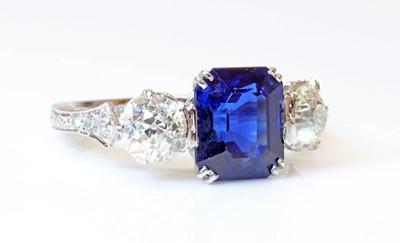 Lot 150 - A three stone sapphire and diamond ring