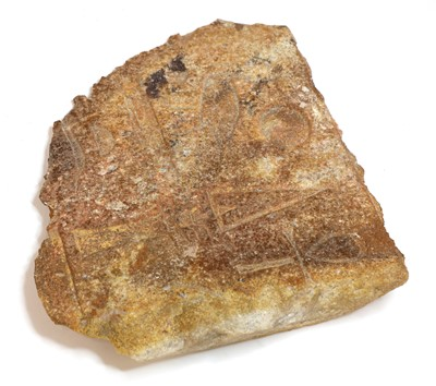 Lot 179 - An Egyptian inscribed quartzite fragment