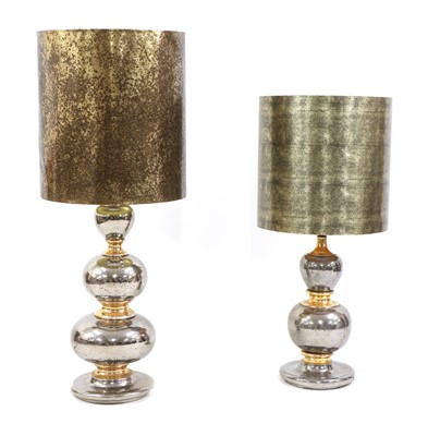 Lot 490 - A near pair of silvered and gilt lamps