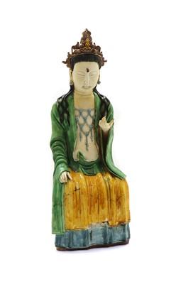 Lot 104 - A Chinese sancai-glazed pottery figure