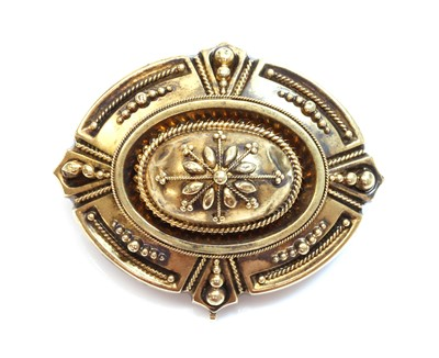 Lot 7 - A Victorian archaeological revival Etruscan style shield form brooch, c.1870