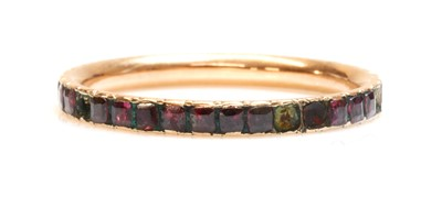 Lot 16 - A Georgian garnet set full eternity ring