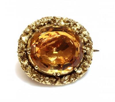 Lot 26 - A William IV gold topaz brooch