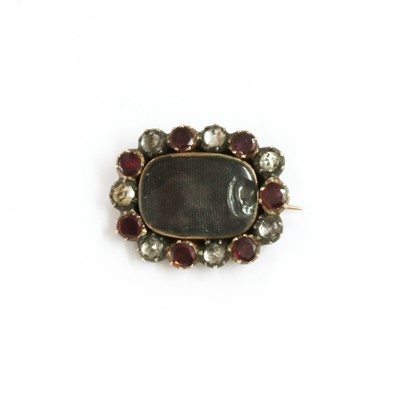 Lot 11 - A Georgian gold and silver, garnet and paste memorial brooch