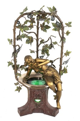 Lot An unusual Art Nouveau cold-painted spelter table lamp