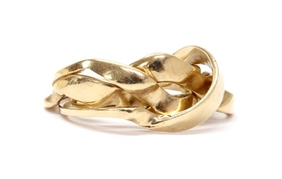 Lot 1083 - A gold four row puzzle ring
