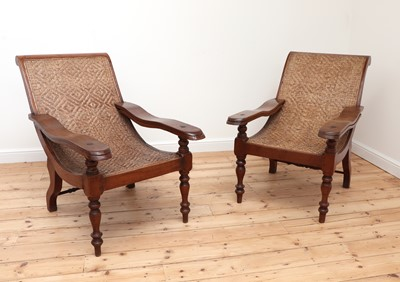 Lot 484 - A pair of Indian teak planter's chairs