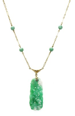 Lot 185 - An American carved jade plaque necklace, c.1925
