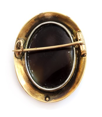 Lot 93 - A Victorian hardstone and split pearl cameo brooch