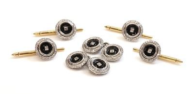 Lot 163 - An Art Deco style diamond and black enamel dress set