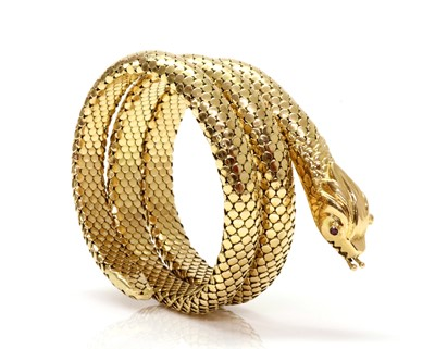 Lot 190 - An Italian ruby set coiled snake style flexible bangle, c.1950