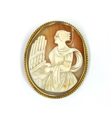 Lot 1012 - A 9ct gold shell cameo brooch