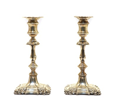 Lot 64A - A pair of Queen Anne style candlesticks by Ellis & Co