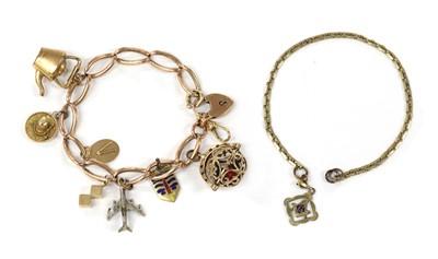 Lot 1100 - A gold charm bracelet
