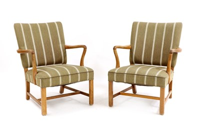 Lot 487 - A pair of Danish oak-framed lounge chairs