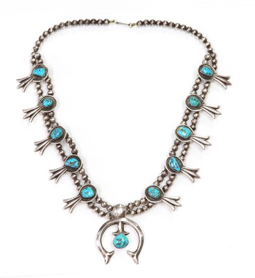Lot 275 - A silver Navajo turquoise squash blossom necklace