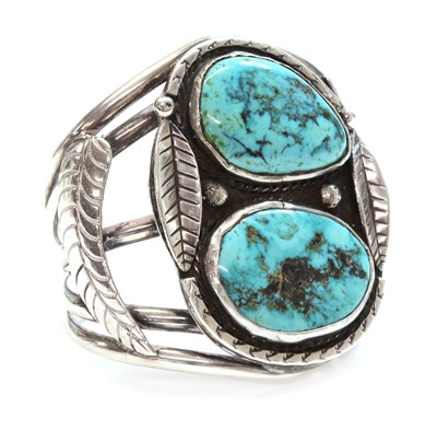 Lot 278 - A silver Navajo turquoise set torque bangle or cuff