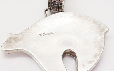 Lot 274 - A silver Navajo Spirit bear pendant, by Thomas Singer