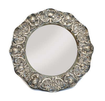 Lot 24 - An Edwardian circular silver easel backed dressing table mirror