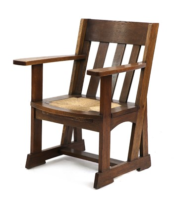 Lot An Athelston oak armchair