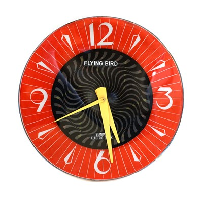 Lot 483 - A Standard Electric 'Flying Bird' wall clock