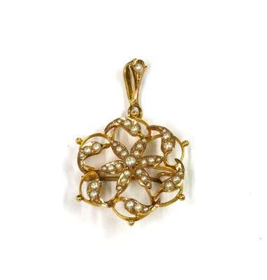 Lot 1034 - A gold split pearl pendant/brooch
