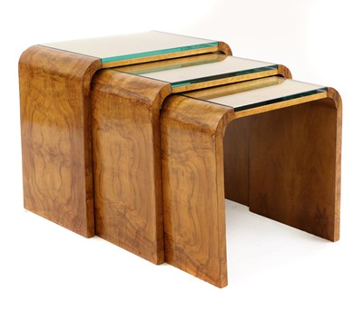 Lot An Art Deco maple nest of tables