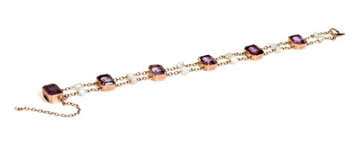 Lot 70 - A rose gold amethyst and pearl bracelet, c.1910