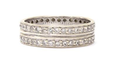 Lot 46 - A white gold two row diamond set full eternity ring