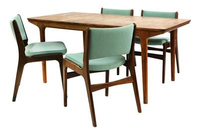 Lot 538 - A teak extending dining table