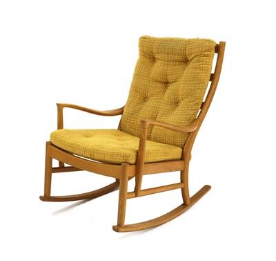 Lot 480 - A Parker Knoll beechwood rocking chair