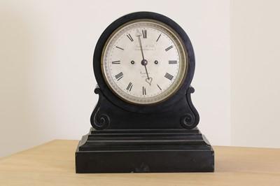 Lot 13 - A black marble drumhead mantel clock