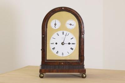 Lot 17 - A Regency brass inlaid rosewood mantel clock